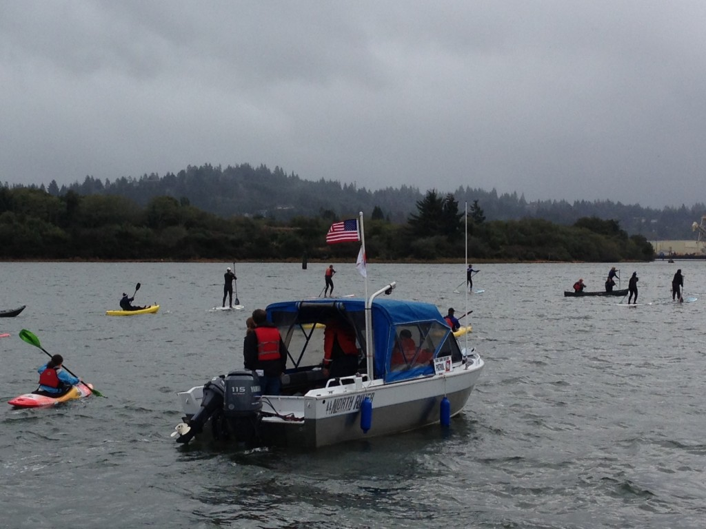 Coast Guard Auxiliary volunteers flank participants for safety in Saturday's stormy conditions